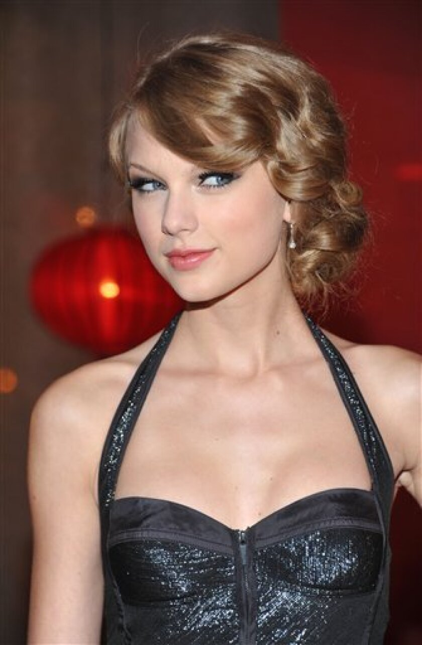 Recording artist Taylor Swift arrives at the 2010 BMI Country Awards Tuesday, Nov. 9, 2010 in Nashville, Tenn. (AP Photo/Evan Agostini)