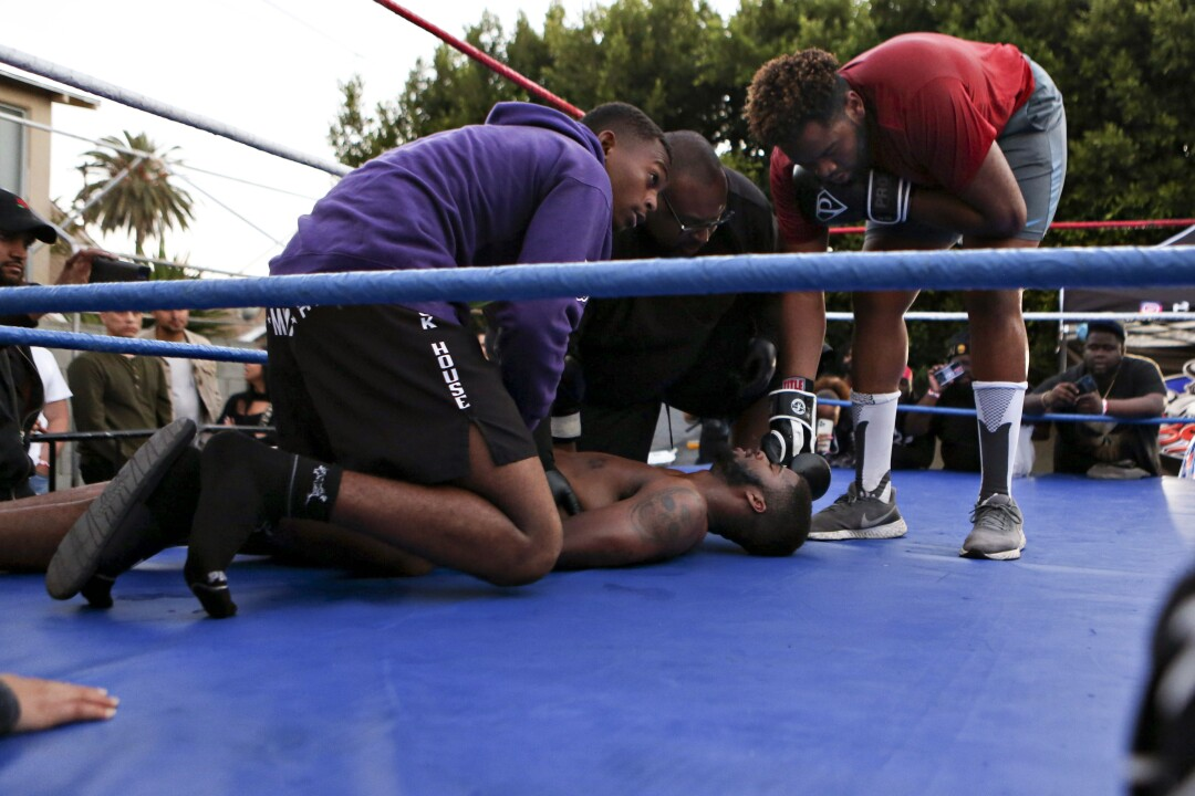 """In the last five seconds of the third round, Big Cheese landed a punch that sent Albert """"Black Blade"""" Marion onto the mat."""
