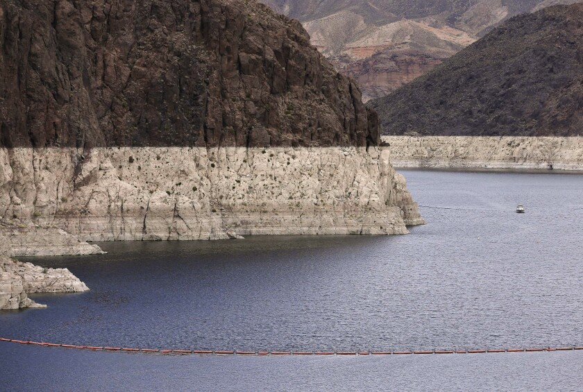 This photo from 2013 shows a bathtub ring marking the high-water line along Black Canyon on Lake Mead. A two-decade-long dry spell is turning into a megadrought in the western United States.