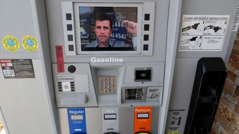 An ad supporting Proposition 6 plays on a screen on a pump at a gas station in Santa Clarita on Oct. 24.
