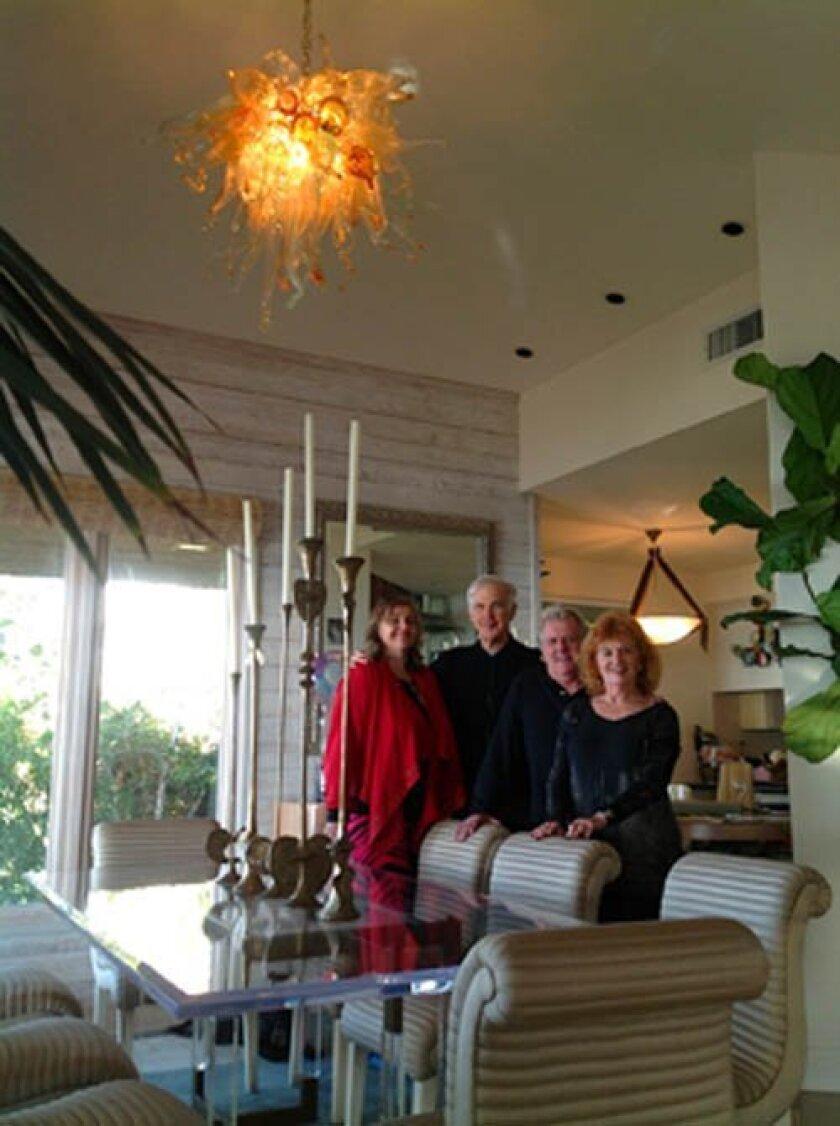 Biljana Beran, Joe Shurman, Terje Lundaas and Gloria Shurman bask in the light of Terje Lundaas's glass sculpture, in the La Jolla home of Drs. Joseph and Gloria Shurman.