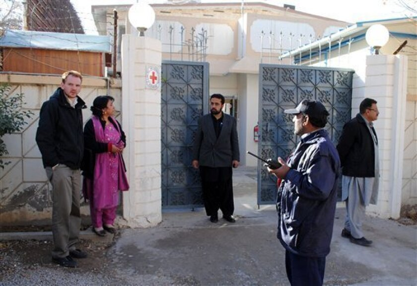 Visitors are standing outside the Red Cross office in Quetta, Pakistan on Thursday, Jan 5, 2012. Armed men seized a Red Cross worker from the southwestern Pakistani city of Quetta on Thursday, police and the organization said. Local police officer Nazir Ahmed Kurd said his initial information was that the man was a British health worker. (AP Photo/Arshad Butt)