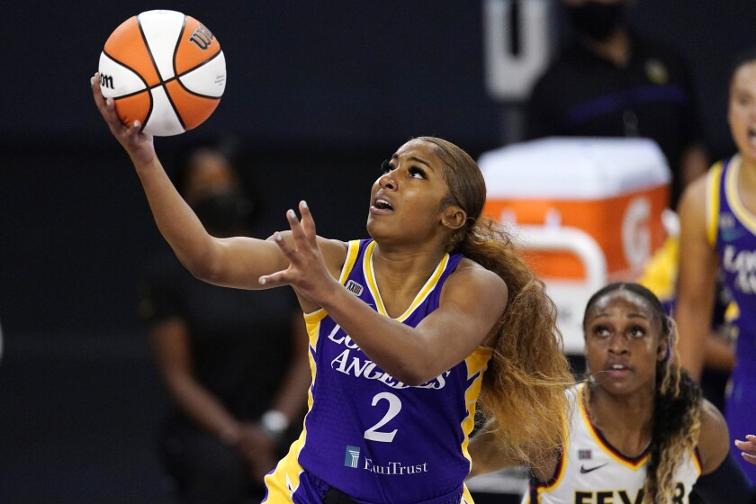 Los Angeles Sparks guard Te'a Cooper, left, shoots as Indiana Fever guard Tiffany Mitchell defends during the first half of a WNBA basketball game Thursday, June 3, 2021, in Los Angeles. (AP Photo/Mark J. Terrill)