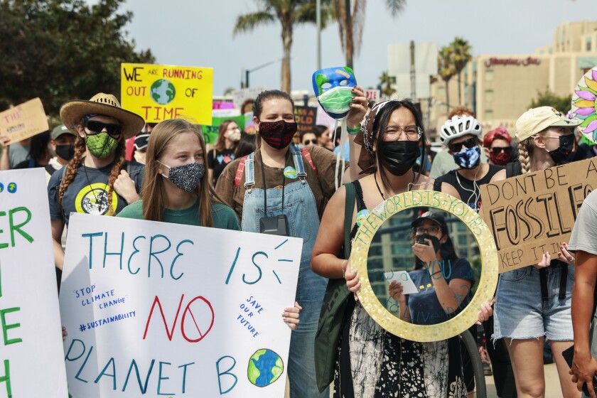 Demonstrators march in downtown San Diego for Friday's climate change rally.