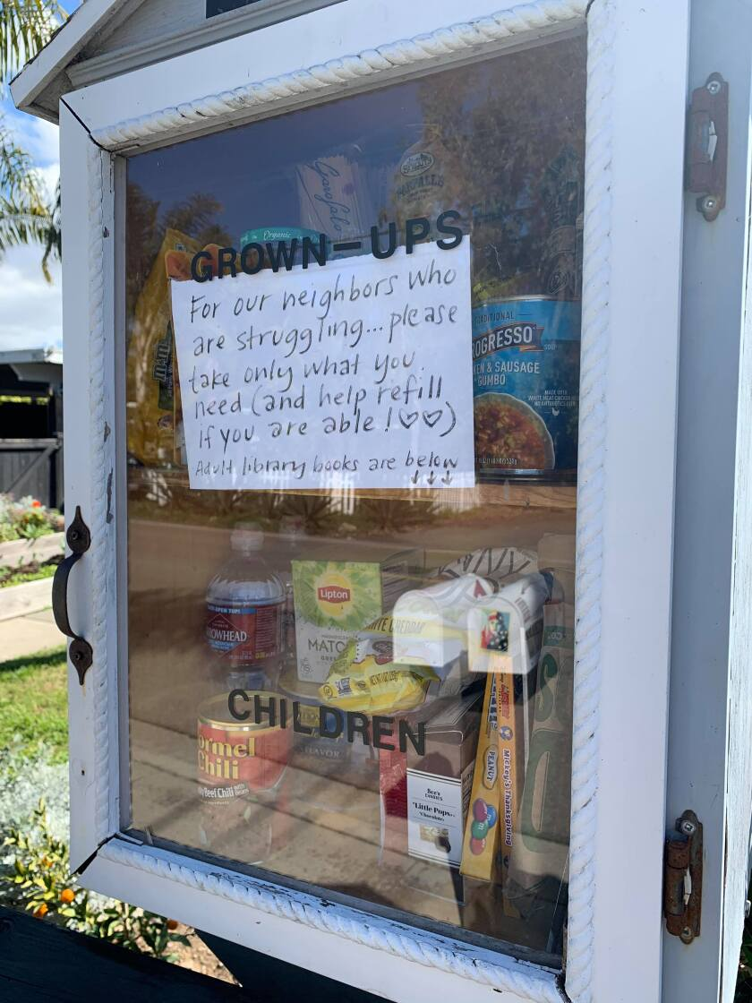 Encinitas resident Tiffany Fox has converted the Little Free Library in front of her home into a food pantry for the duration of the COVID-19 crisis.