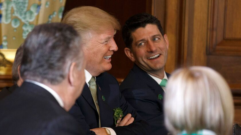 President Trump laughs with US Speaker of the House Paul Ryan at the United States Capitol in Washington on March 15.