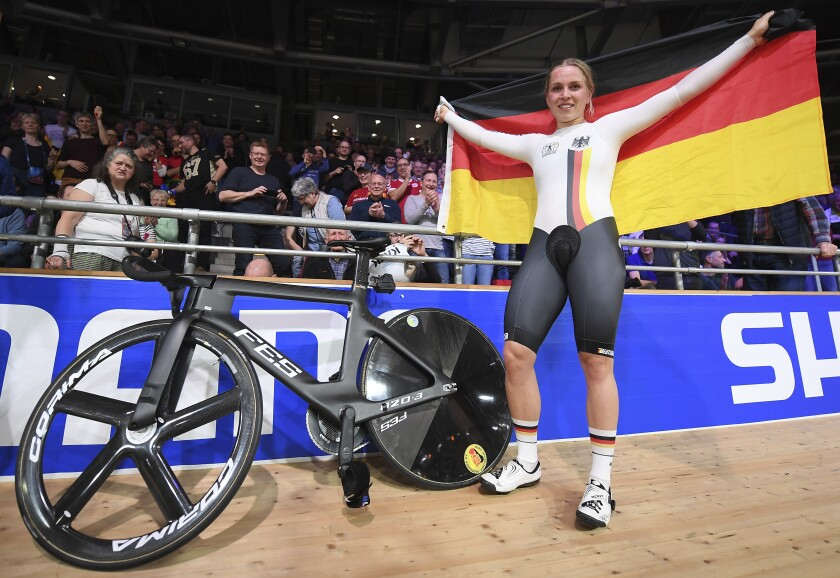 Emma Hinze from Germany celebrates winning the Women's sprint final during the Cycling World Championship in Berlin, Germany, Friday Feb. 28, 2020. (Sebastian Gollnow/dpa via AP)