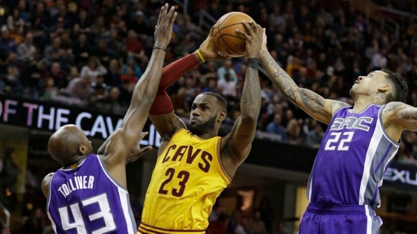 Kings' Arron Afflalo's late basket sinks the Cavaliers in overtime