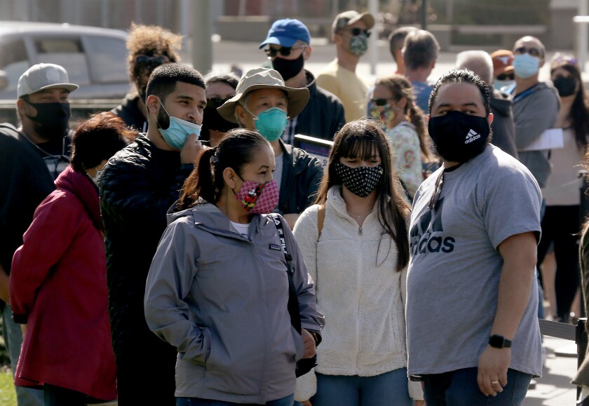 People wear masks at Golden Gate Park in San Francisco.