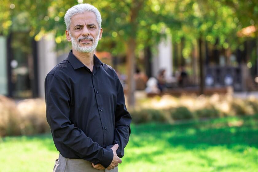 Dr. Wael Al-Delaimy poses for portrait.