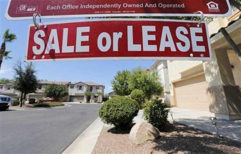 FILE - In this Tuesday, July 30, 2013, file photo, A home is seen for sale Tuesday, July 30, 2013 in Gilbert, Ariz. Freddie Mac reports quarterly earnings on Tuesday, Aug. 7, 2013. (AP Photo/Matt York)
