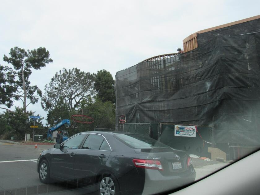 The edifice under construction at Coast Walk and Torrey Pines Road.