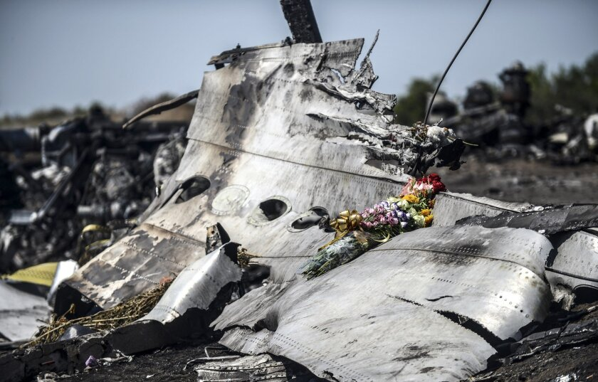 Much of the wreckage of Malaysia Airlines Flight 17, seen in this July 26, 2014, photo from the crash site in eastern Ukraine, has been taken to a Dutch air base and reconstructed to aid investigators in their search for the cause and perpetrators of the disaster.