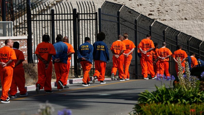 SAN QUENTIN, CALIF. -- TUESDAY, AUGUST 16, 2016: Inmates walk in file in front at San Quentin State