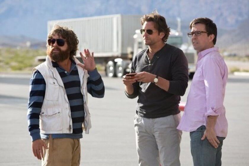 """Zach Galifianakis, left, Bradley Cooper and Ed Helms in """"The Hangover Part III."""""""