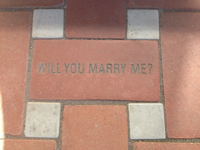 This is the brick Jonathan Moore bought and had inscribed for the courtyard of the new library. He took his girlfriend, Amber Garcia, there on Sept. 28  and proposed.