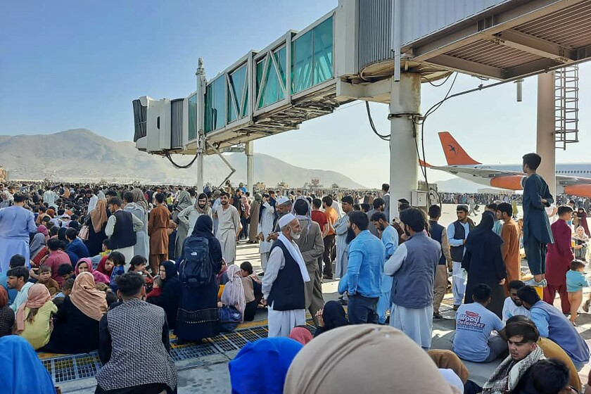 Afghans crowd the Kabul airport on Monday, trying to flee the country as the Taliban seized control.