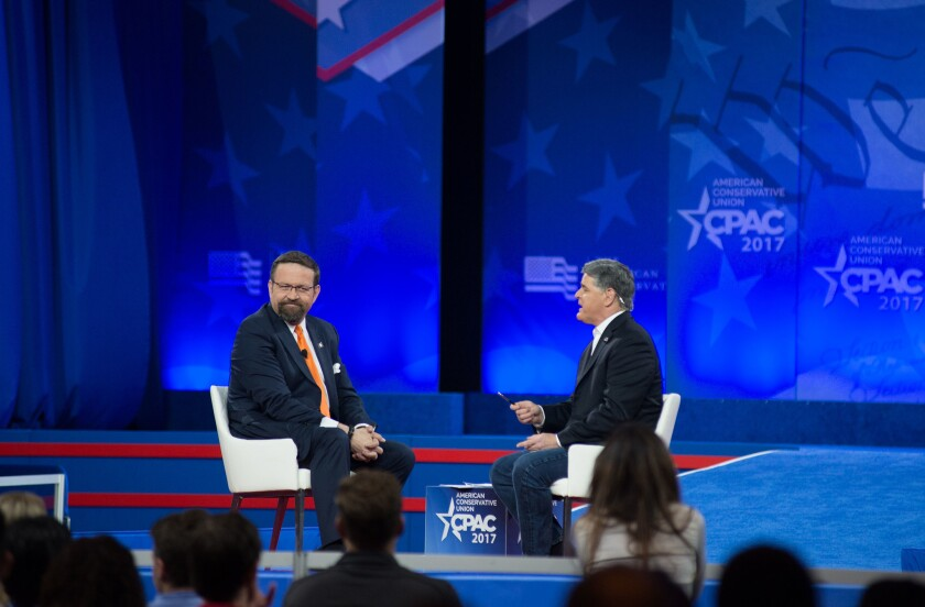 Sebastian Gorka, left, appears on stage with Sean Hannity at CPAC on Feb. 23, 2017, in National Harbor, Md.