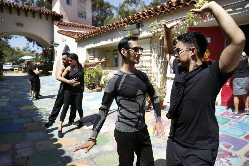 """John Diaz and Ian Isles practice with other dance troupe members for their portion of this year's """"Trolley Dances"""" performances."""
