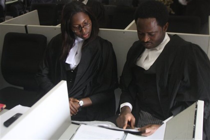 Lawyers Tope Adebayo, right, and Flora Ogbuitepu, left, prepare for a court hearing representing an organization called the Save Nigeria Group over the deployment of soldiers during January fuel protests in Lagos, Nigeria on Tuesday, April 3, 2012. A lawsuit challenging soldiers ending a massive Nigeria protest over spiking gasoline prices has reached the country's court system, testing the power of the nation's president to use the military to quell peaceful dissent. (AP Photo/Jon Gambrell)