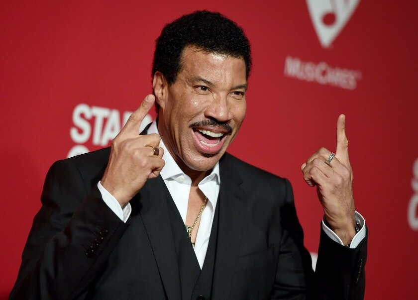 Lionel Richie arrives at the MusiCares Person of the Year tribute in his honor at the Los Angeles Convention Center on Saturday, Feb. 13, 2016. (Photo by Jordan Strauss/Invision/AP)