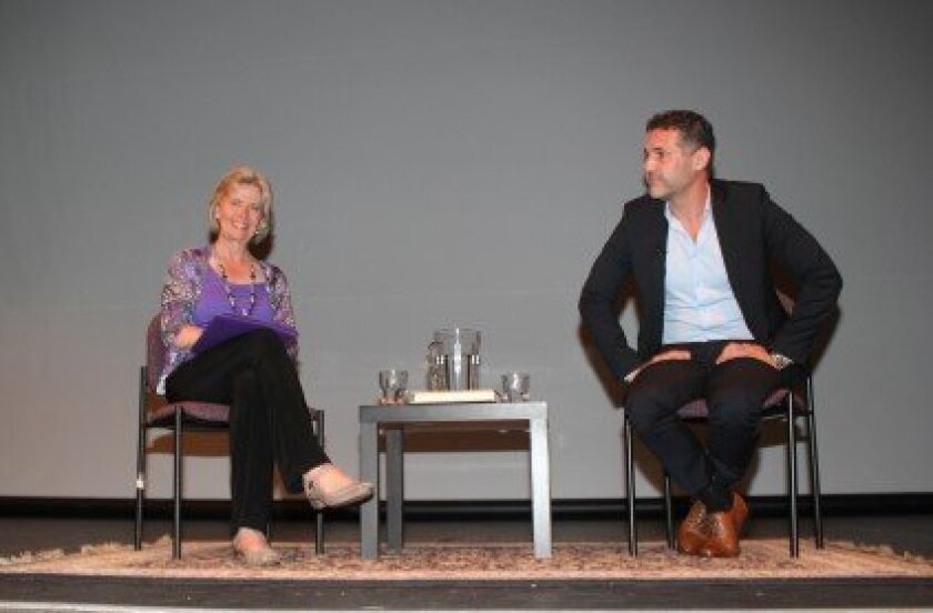 Martha Barnette, host of public radio's 'A Way With Words,' interviews best-selling author and UCSD graduate Khaled Hosseini at the Museum of Contemporary Art on June 26.