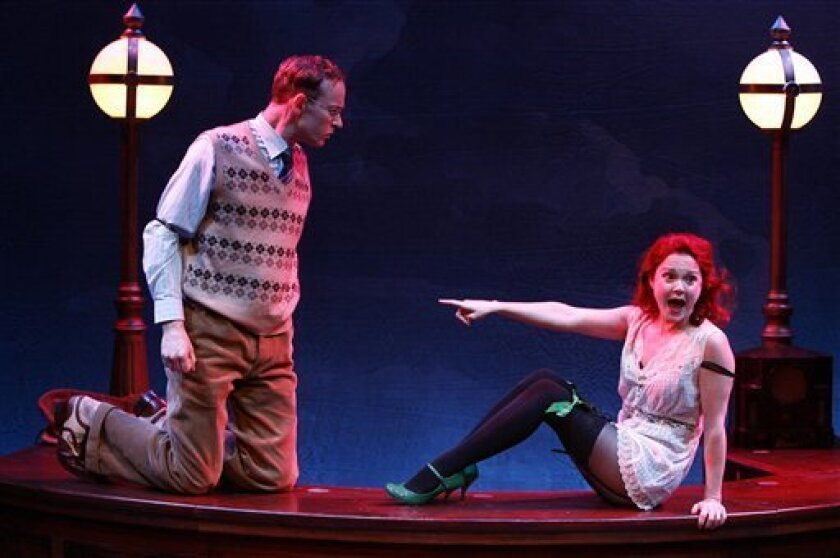 """In this image released by Karen Greco PR, Peter Hanly, left, and Sarah-Jane Drummey are shown in a scene from """"Improbable Frequency,"""" playing at off-Broadway's 59E59 Theaters in New York. (AP Photo/Karen Greco PR, Carol Rosegg)"""