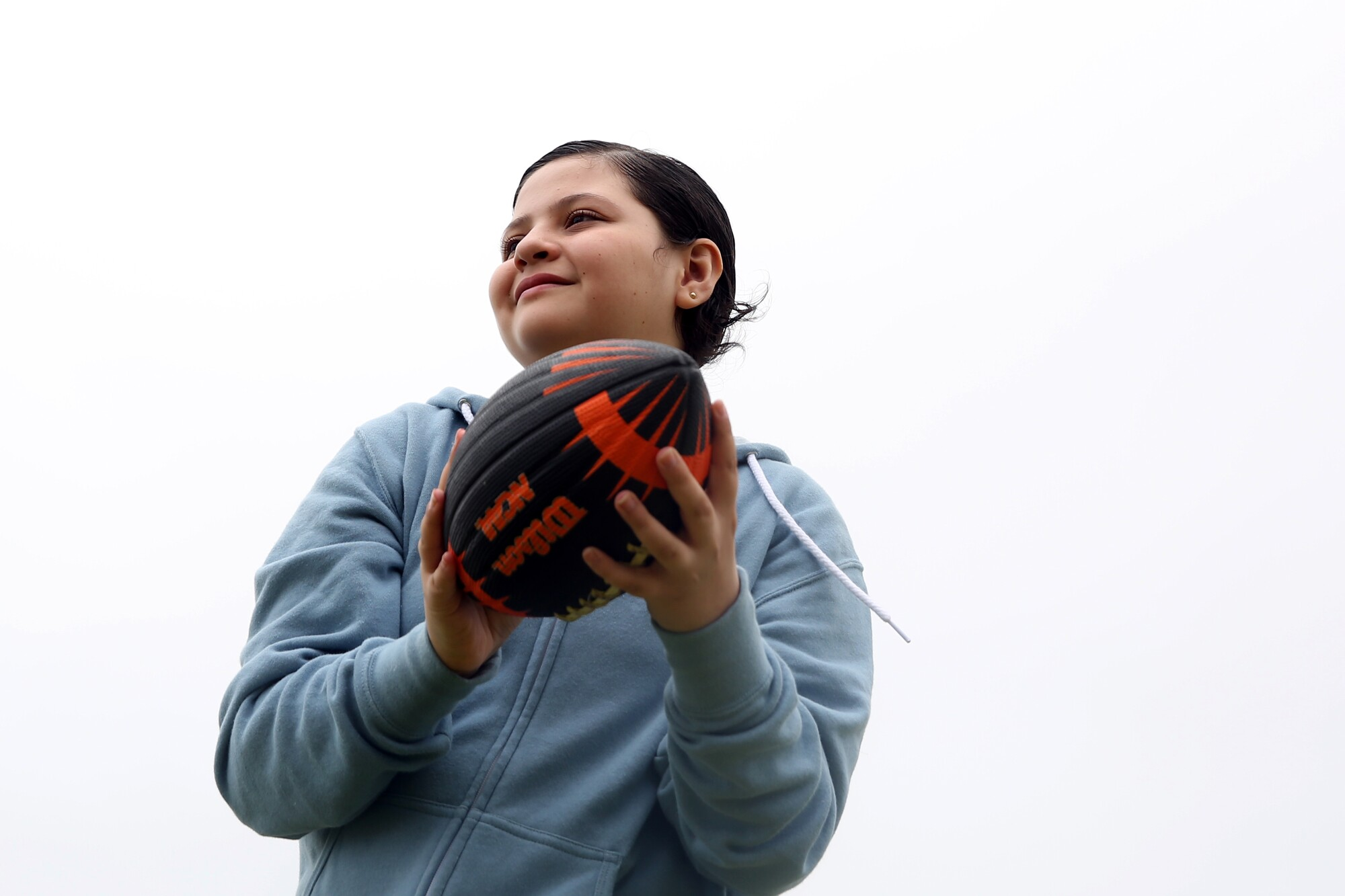 Kayla Diaz, 12, tosses the football with her mom at Point Fermin Park.