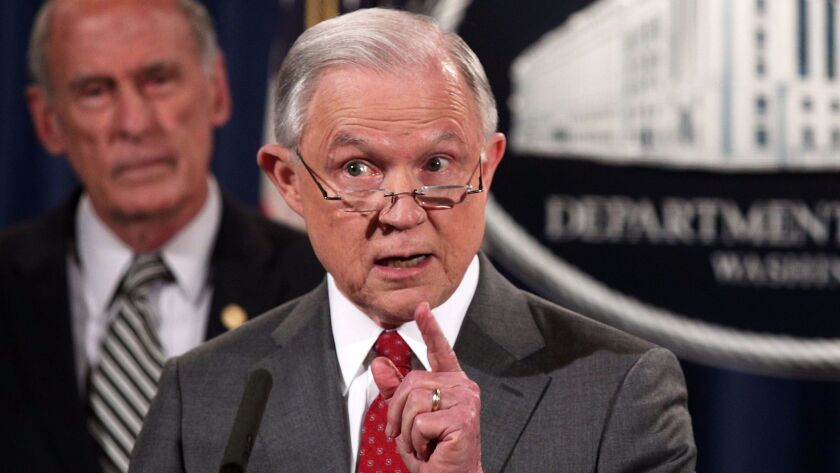 Atty, Gen. Jeff Sessions, shown speaking to reporters at the Justice Department, has threatened to c