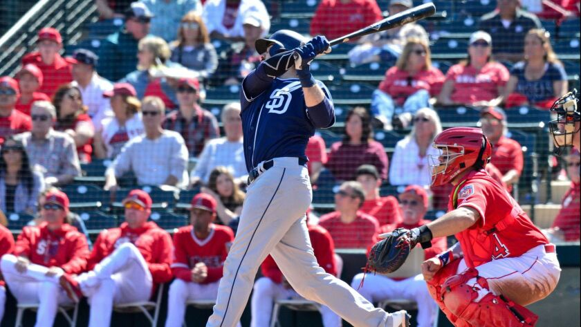 Padres catcher Austin Hedges hits a solo home run in the second inning against the Los Angeles Angels on Sunday.