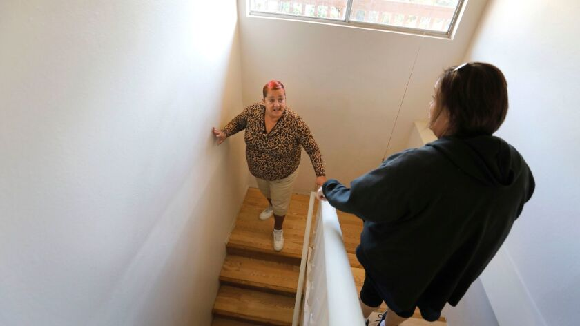 Lynette Gresham is the first of hundreds of people living in three industrial tents set up for homeless people in San Diego to transition through the program to permanent housing.