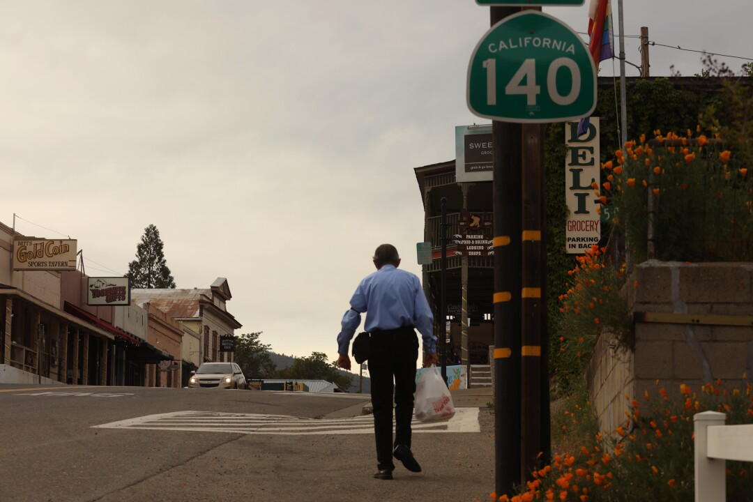 Bill Evans walks home along Highway 140 in Mariposa