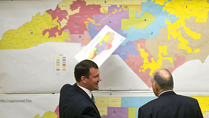 Republican state Sens. Dan Soucek, left, and Brent Jackson review historical maps of North Carolina in 2016.
