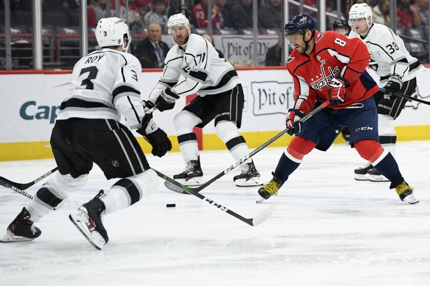 Washington Capitals left wing Alex Ovechkin (8) skates with the puck in front of Kings defenseman Matt Roy (3) during the second period on Tuesday in Washington.