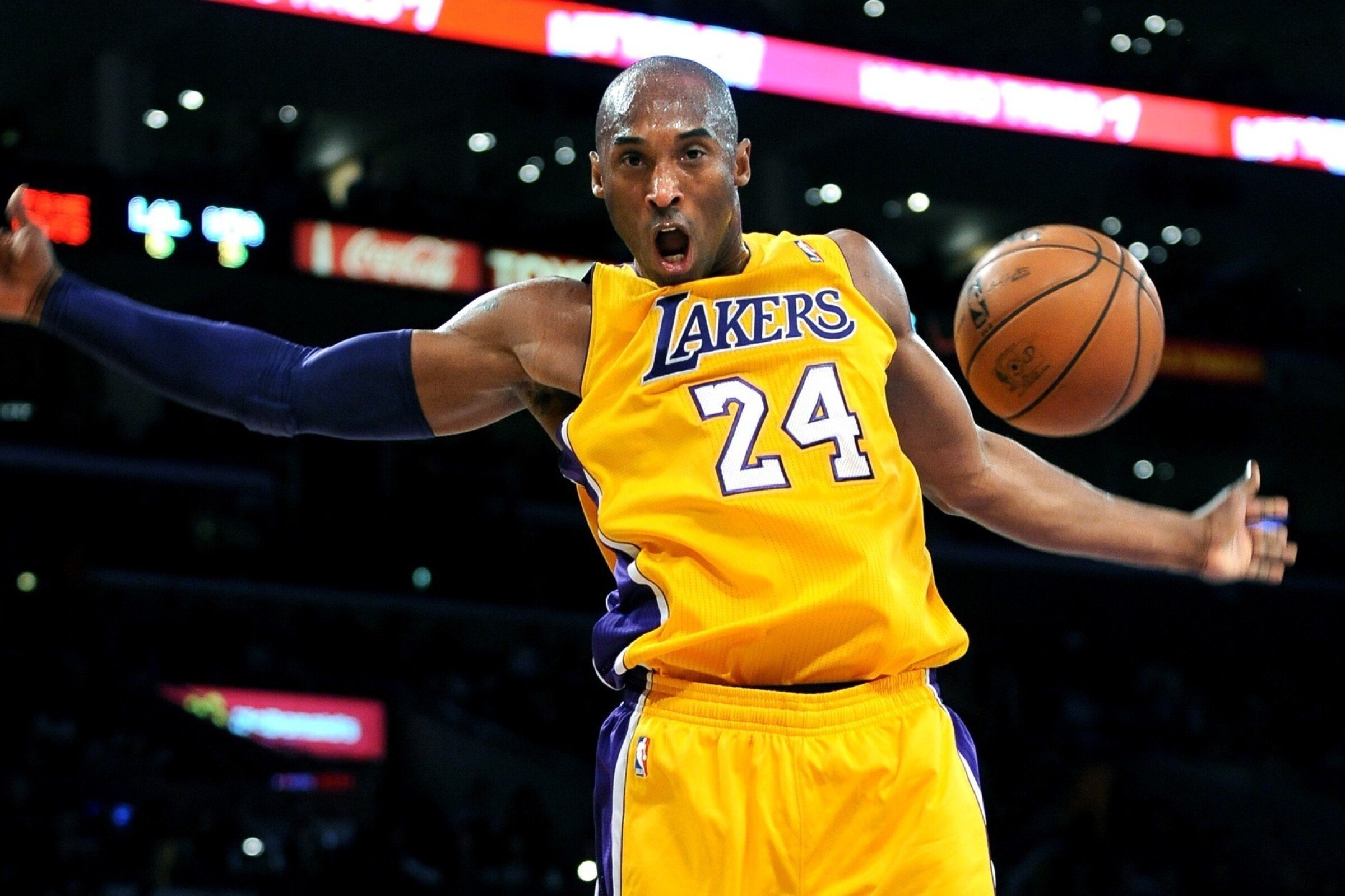 Kobe Bryant dunks during a game in 2012.