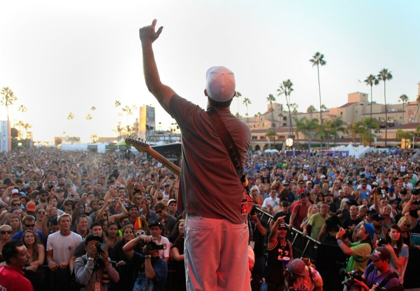 Miles Doughty of the band Slightly Stoopid pumps up the crowd at last year's KAABOO festival at the Del Mar Racetrack.