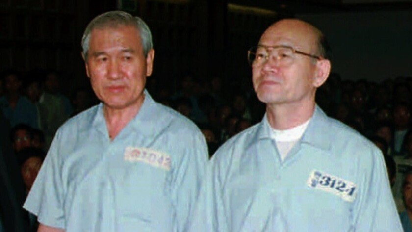 Former leaders Roh Tae-woo and Chun Doo-hwan, right, in Seoul District Court on Aug. 26, 1996, where they were convicted of treason for their role in a 1979 coup, and for corruption during their tenure as South Korea's president.