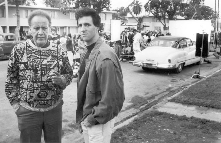 "Bob Richardson, left, and Michael Lazarou in 1990 on the set of ""Heat Wave,"" a movie about the Watts riots."