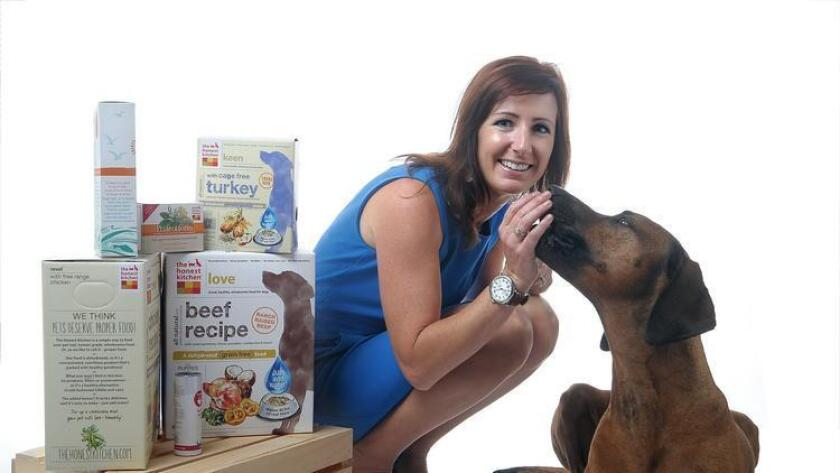Lucy Postins, founder and CEO of The Honest Kitchen and her dog Taro. (/ Rick Nocon)