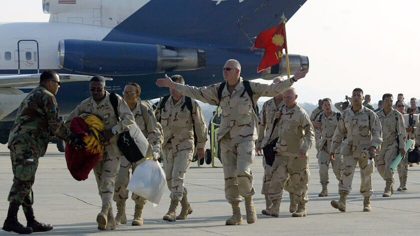 In this file photo, California National Guardsmen arrive at March Air Force Base in Riverside County after serving a year in Iraq.