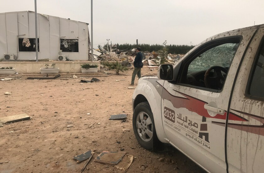 Destroyed buildings are seen at an airport complex under construction in Karbala, Iraq, Friday, March 13, 2020. Iraq's military said five security force members and a civilian were killed early Friday in a barrage of U.S. airstrikes, which were launched hours after a rocket attack killed and wounded American and British servicemen at a base north of Baghdad. (AP Photo/Anmar Khalil)
