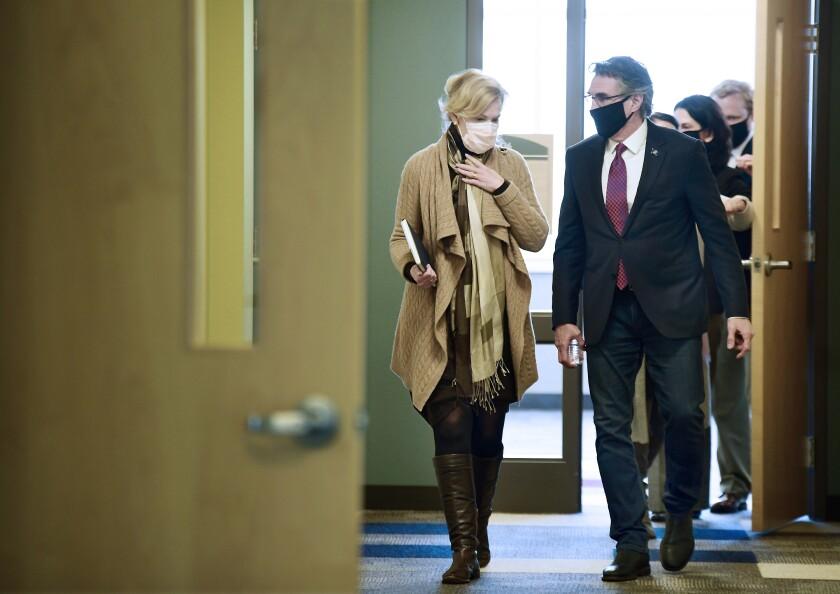 Dr. Deborah Birx, White House coronavirus response coordinator, left, walks with North Dakota Gov. Doug Burgum.
