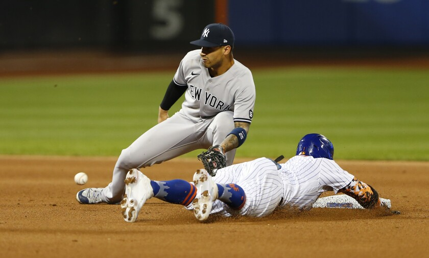 New York Mets' Jonathan Villar beats the throw to New York Yankees' Gleyber Torres for a stolen base during the fourth inning of a baseball game on Sunday, Sept. 12, 2021, in New York. (AP Photo/Noah K. Murray)