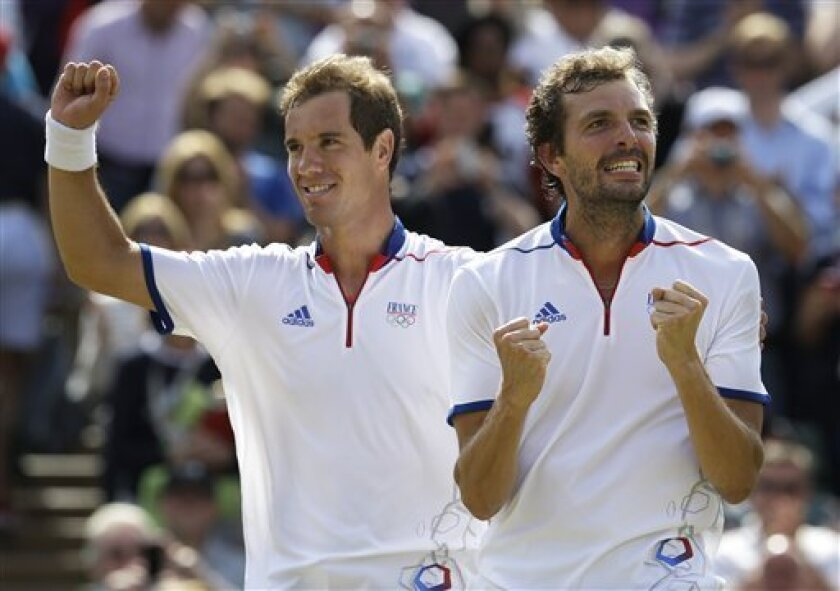 Richard Gasquet, left, and Julien Benneteau of France celebrate after beating David Ferrer and Feliciano Lopez of Spain in the men's doubles bronze medal match at the All England Lawn Tennis Club at Wimbledon, in London, at the 2012 Summer Olympics, Saturday, Aug. 4, 2012. (AP Photo/Mark Humphrey)