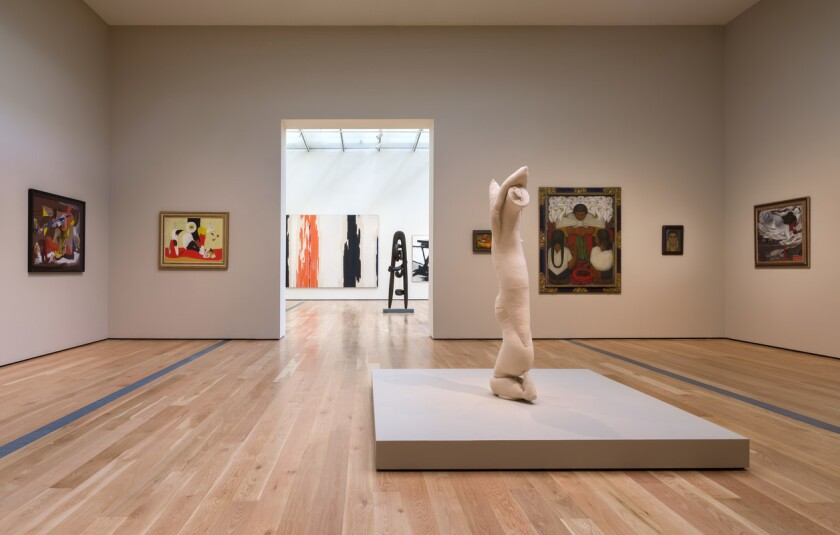 A gallery full of art at a museum.