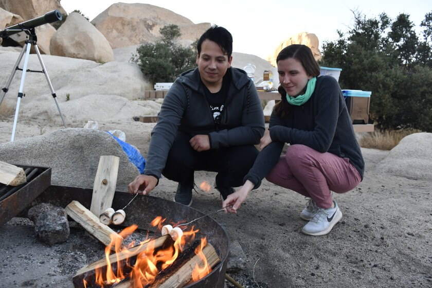 Campers Edgar Carrillo and Holly Hirschi roast marshmallows May 20 at Hidden Valley campground in Joshua Tree National Park.