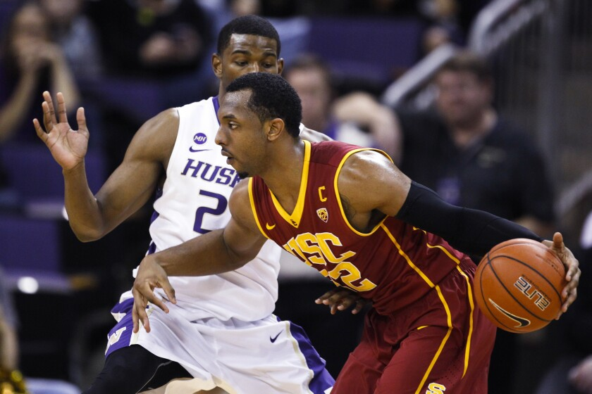 USC guard Byron Wesley, right, drives past Washington guard C.J. Wilcox during the Trojans' Pac-12 tournament loss. The former USC player reportedly says he's been contacted by several schools who are interested in him.
