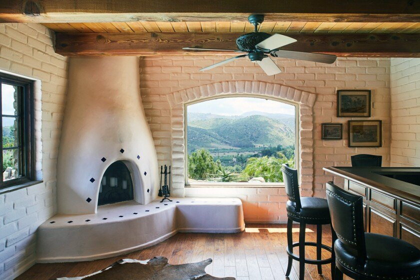HOTCHKISS ADOBE: A traditional kiva fireplace creates a focal point by a window overlooking the San Pasqual Valley.