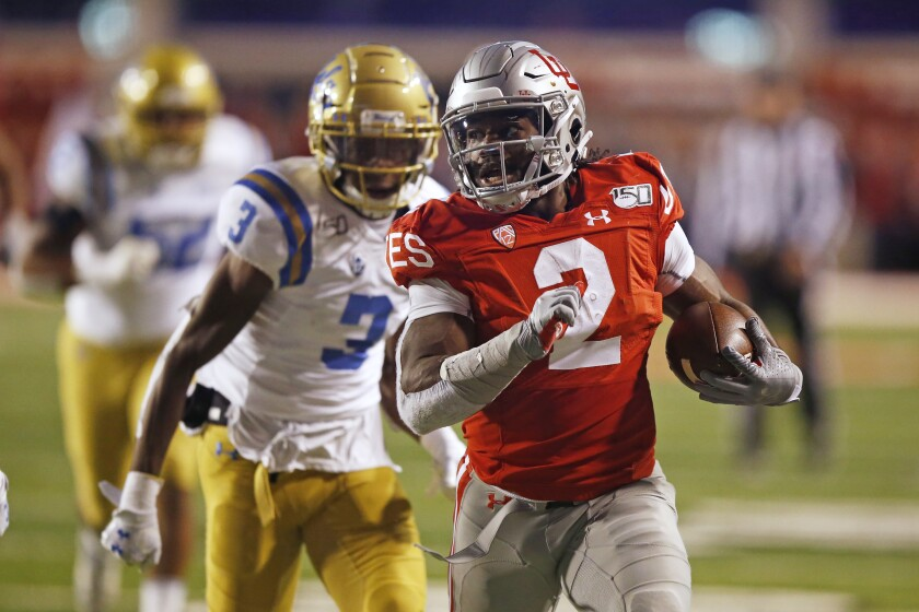 Utah running back Zack Moss leaves UCLA defensive back Rayshad Williams behind on his way to scoring a touchdown.