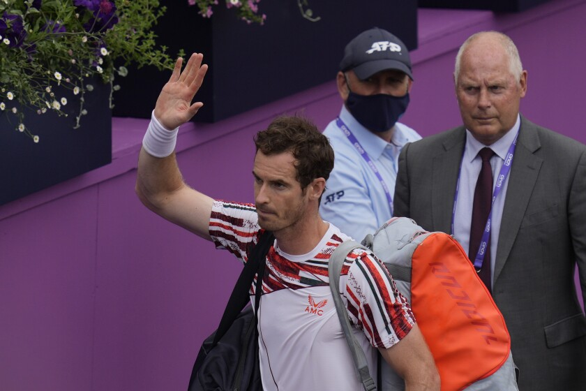Andy Murray of Britain waves as he leaves court after he loses against Matteo Berrettini of Italy during their singles tennis match at the Queen's Club tournament in London, Thursday, June 17, 2021. (AP Photo/Kirsty Wigglesworth)